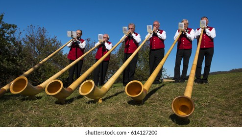 Sasbachwalden, Black Forest, Baden Wuerttemberg, Germany – October 16, 2016: To the alp power take-off play alphorn musicians. The celebration takes place once a year