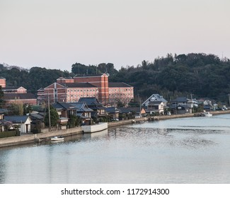 Sasebo, Japan - 10MAR2018: Apartment building along river near Sasebo, Japan.