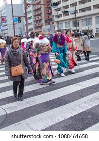 Sasebo, Japan - January 7, 2018: Japanese women crossing the street during the coming of age day celebration in Japan.