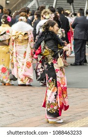 Sasebo, Japan - January 7, 2018: Excited Japanese woman in Kimono at coming of age day in Japan.