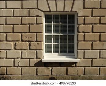 sash window in rusticated wall