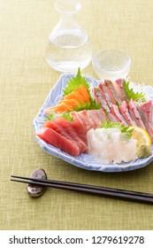 Sashimi assortment and cool Japanese sake