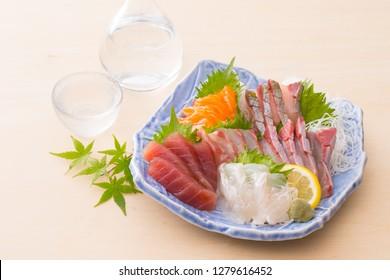 Sashimi assortment and cool sake