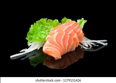 Sashimi Sake sushi with salmon on black background