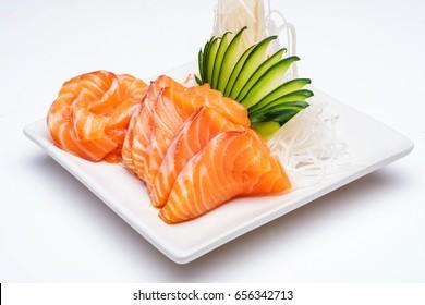 Sashimi, Salmon, Japanese food chopsticks and wasabi on the white table