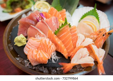 sashimi set with different fresh fish sliced on plate, close-up