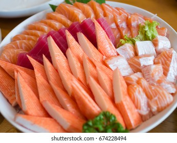 Sashimi set including crab stick, tuna, salmon and salmon belly, the Japanese food. Each piece fit for one bit. Eat its raw. Focus at middle row.