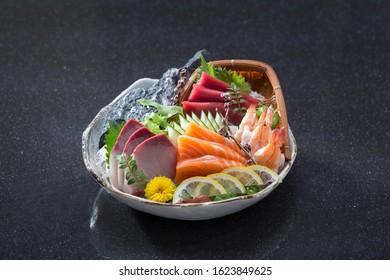 Sashimi set a taste of the Japanese cuisine isolated on black background