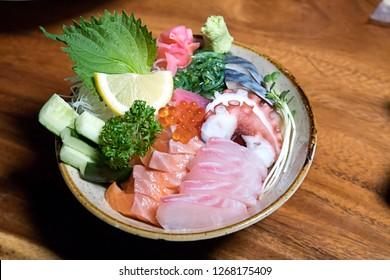 sashimi,salmon sashimi , tuna sashimi, crab sticks,squid sashimi and Tamako Sashimi, Sweet Egg served on traditional Japanese food in dish or black bowl - Image