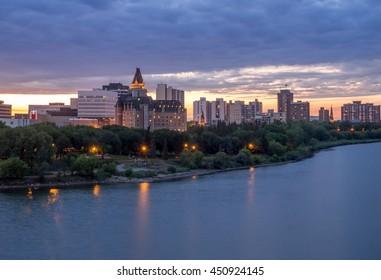 Saskatoon skyline at night along the Saskatchewan River.