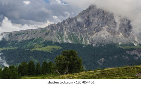 Sass de Putia, the solitary mountain, as seen in rainy and cludy weather  from Monte Muro mountain refuge, located in Kronplatz region, Dolomites, South Tyrol, Italy