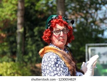 Sassenheim, Netherlands - April 21st 2018 : Bloemencorso Bulb Flower parade. Pantomime Dame
