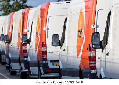 SASSENHEIM, NETHERLANDS - JULY 7, 2019: PostNL delivery vans. PostNL is a mail, parcel and e-commerce corporation with operations in the Netherlands, Germany, Italy, Belgium, and the United Kingdom.