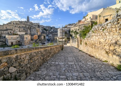 The Sasso Barisano Matera Cathedral tower rises above the sassi prehistoric area of Matera Italy with the ancient and medieval dwellings in the Basilicata city of Matera Italy.