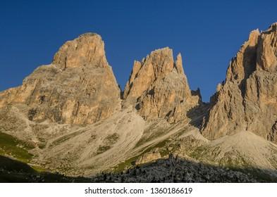 Sassolungo and Sassopiatto mountain group with Cinque Dita and Sassolungo mountain passes in between, as seen on the trail from Passo Sella refuge to Sassopiatto refuge, Dolomites, Italy