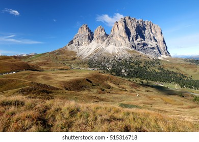 Sassolungo, Val Gardena, Dolomites, Italy. The Sassolungo alp standing over colorful fields during the summer season in Val Gardena, Trentino Alto Adige, Italy.
