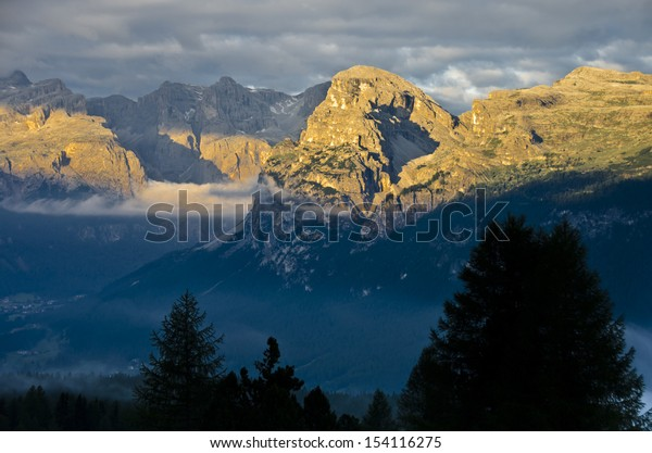 Sassongher and Gruppo del Sella at sunrise, as seen from Rifugio Santa Croce, Alta Badia, Dolomites, South Tyrol, italy