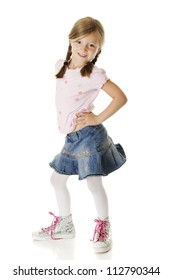 A sassy elementary girl in a denim skirt and sparkling high-top sneakers with bright, heart-covered laces.  On a white background.