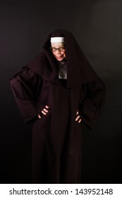 A sassy nun with hands on her hips
