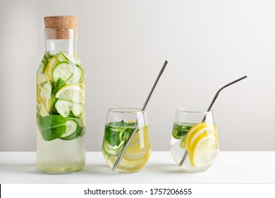 Sassy water slimming or infused water with lemon,mint, cucumber and ginger in glasses with metal tubes. Zero waste concept.