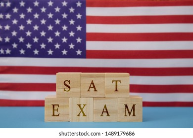 SAT Exam in WOoden blook letters on US flag