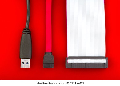 Sata cable, usb and ide cables on a red background. Flat lay. The concept of changing data storage