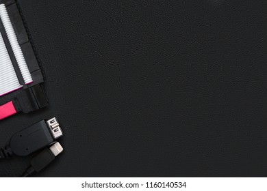 Sata cable, usb and ide cables on the black desktop with copy space. Computer storage concept.