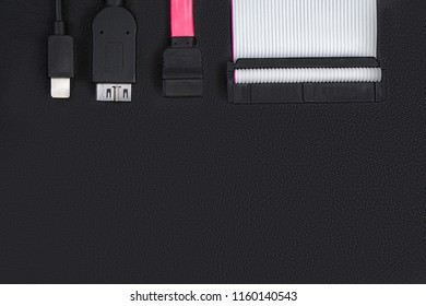 Sata cable, usb and ide cables on the black desktop. Top view. The concept of data storage