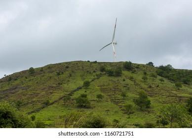 Satara / India 16 August 2018 Wind Power Project in rural village at Satara green Valley in Maharashtra India