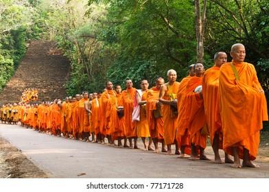 Satchanalai District. Sukhothai, THAILAND - APRIL 13: Thai people celebrate Songkran festival (water festival) in Satchanalai District. Sukhothai, Thailand on April 13, 2011. Row of Buddhist monks.