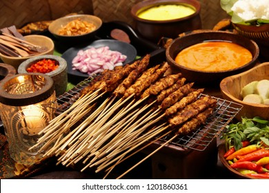 Sate Ayam Blora. Chicken satays from Blora regency in Central Java. Served with peanut sauce, rice or rice cake, yellow curry soup, and assorted condiments.