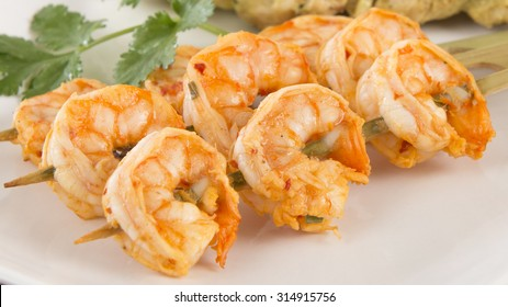 Sate Goong - Thai prawn satays served with peanut sauce. Close up.
