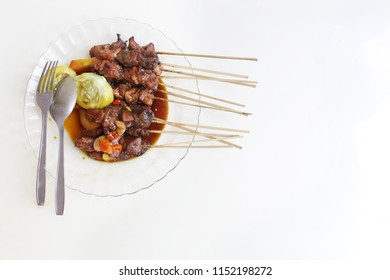 Sate kambing Lamb satay Traditional food from indonesia. sate klatak traditional food made from grilled goat meat.