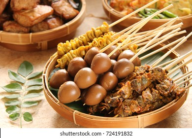 Sate Usus, Sate Telur Puyuh, Sate Kerang. Skewered food dish of chicken intestine, quail eggs, and cockles. Popular side dishes in Javanese meals. Served on woven bamboo plate.