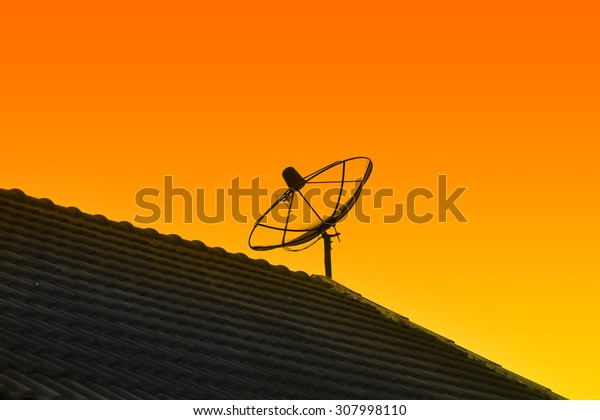Satelite dish and orange sky background.