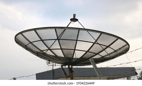satellite above the house against the sky background