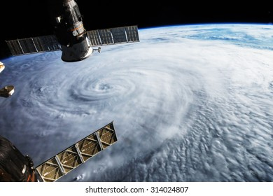 Satellite above hurricane on earth. Some graphics are provided by NASA.