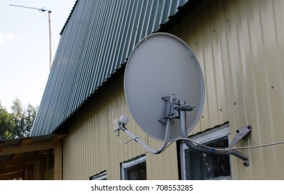 Satellite antenna on the wall of rural houses