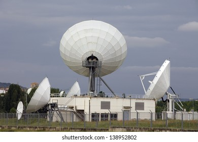 Satellite Antenna over a Building. Horizontal View of Several Big Satellite Dish in a Communication Center