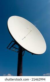Satellite communication antenna against the blue sky