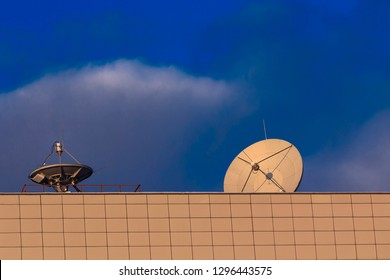 Satellite communications dishes on roof of scientific research institute