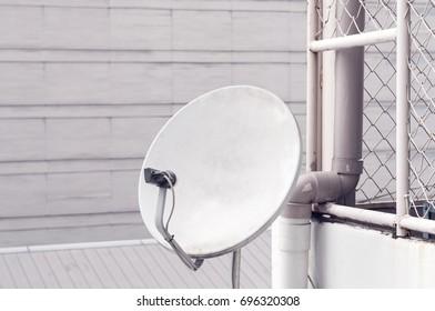 satellite dish antenna mounted on building