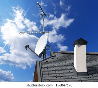 Satellite Dish and Antenna TV on Blue Sky / Satellite dish and TV antennas on the house roof with a beautiful blue sky