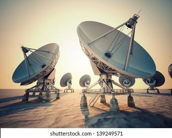 Satellite dish array at sunrise.