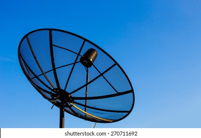 Satellite dish and blue background
