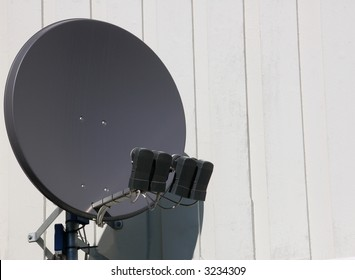 Satellite dish with four microwaveheads mounted on wall
