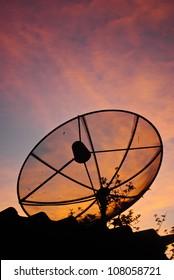Satellite dish in morning sky