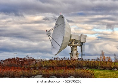 Satellite dish on a cloudy sky