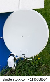 satellite dish on a outer wall