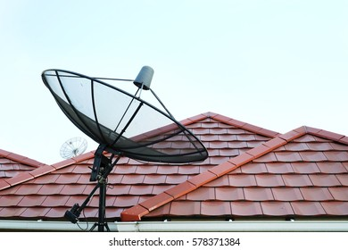 Satellite dish on the red roof